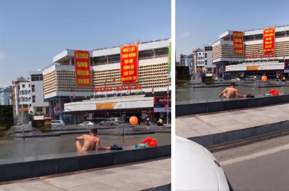 Người đàn ông thản nhiên thả rông ngồi nghịch nước dưới chân cột đồng hồ 35 tỷ giữa trung tâm TP Hạ Long-1
