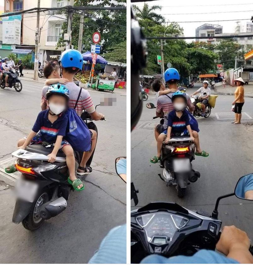 Một tay bế con một tay lái xe máy, phía sau còn cho con trai ngồi đối lưng vắt vẻo, ông bố trẻ nhận vô số chỉ trích-1