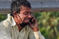 Câu chuyện đằng sau bức ảnh người cha khắc khổ bật khóc bên đường khi hay tin con ốm mà không có tiền về nhà gây chấn động thế giới