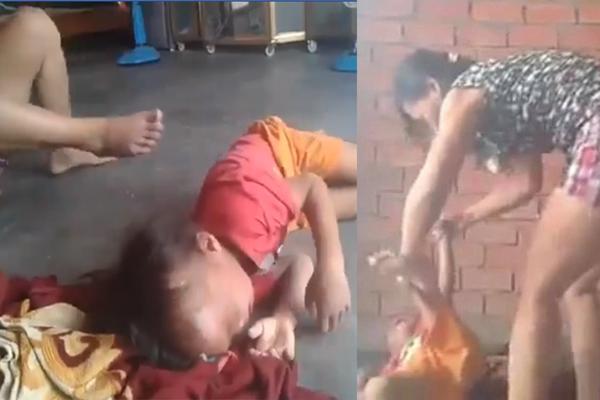 Người phụ nữ đánh tới tấp vào đầu, bóp cổ bé trai 5 tuổi