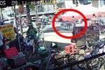 Sang đường bất cẩn, người đàn ông suýt mất mạng dưới bánh xe container