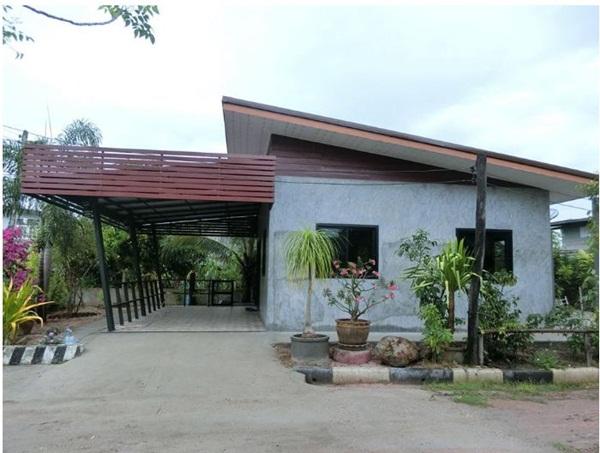 Ngôi nhà cấp 4 xây dựng đơn giản nhưng sở hữu khoảng sân rộng đủ để ngắm trọn vẻ đẹp xanh tươi của thiên nhiên xung quanh-1