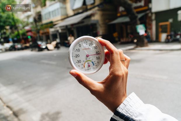 Ảnh: Nắng nóng tiếp tục gay gắt trên 40 độ C, người dân vật lộn tìm đủ mọi cách tránh nóng-1