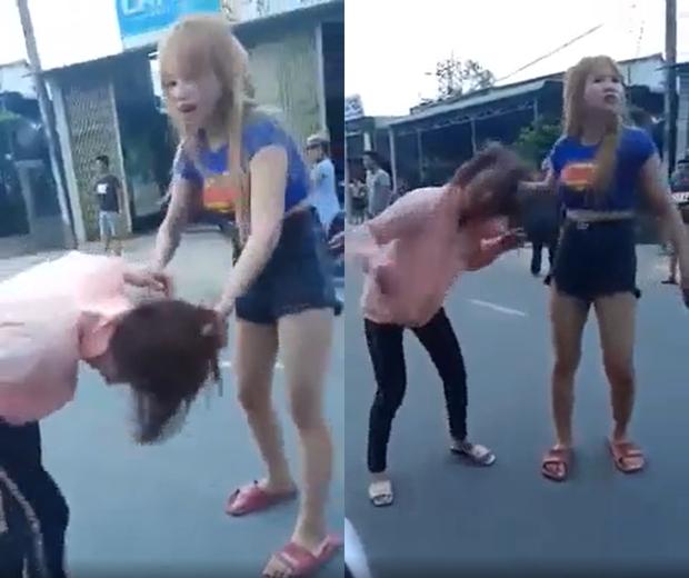 Xôn xao clip Xôn xao clip cô gái trẻ bị đôi nam nữ đánh tới tấp giữa đường-1