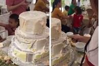 Dân mạng 'giật mình' với clip các em bé cạo vỏ bánh cưới để ăn mà không dám đụng phần nhân, hóa ra sự thật về những chiếc bánh cưới hoành tráng là đây