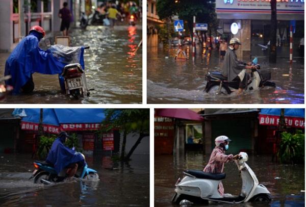 Mưa lớn trút xuống hàng giờ khiến nhiều tuyến phố Hà Nội thành sông, ô tô và xe máy bơi trong nước-11