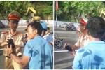 CSGT Tuyên Quang lên tiếng sau khi bị tố dùng gậy vụt vào mặt người phụ nữ vì không chấp hành hiệu lệnh dừng xe-2