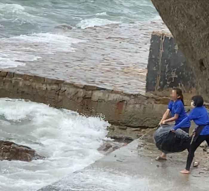Nhân viên và chủ quán cà phê vứt rác xuống biển bị phạt 35 triệu đồng-1