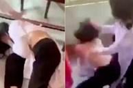 Nữ sinh lớp 9 bị đánh hội đồng, xé áo trước cổng trường