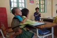 Thầy hiệu trưởng tiết lộ tin ấm lòng về bé 7 tuổi cõng em 20 tháng đến lớp học 1