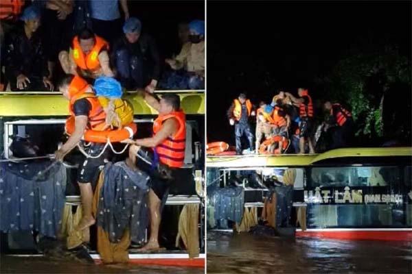 Xe khách bị lũ cuốn trôi, hàng chục người phá kính trèo lên nóc xe k