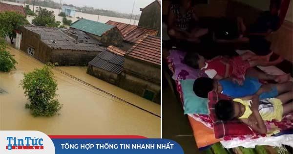 Quảng Bình: Nước lũ dâng cao, Người dân kêu cứu giữa biển nước