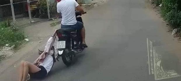 Clip tên cướp kéo lê cô gái hàng trăm mét trên đường phố Sài Gòn gây phẫn nộ-1