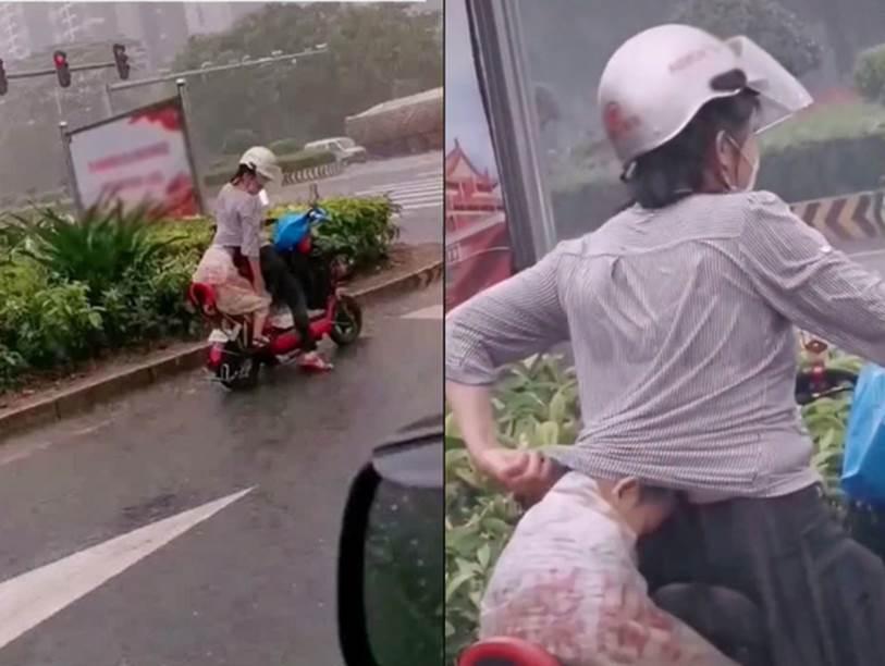 Em bé núp sau mẹ lưng như ninja trên đường phố, cảnh tượng vừa hài hước vừa cảm động vì manh áo mẹ luôn là tấm khiên bảo vệ an toàn nhất-2