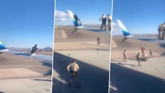 Khoảnh khắc người đàn ông trèo lên cánh máy bay khi chuẩn bị lăn bánh khiến người xem đứng hình-2