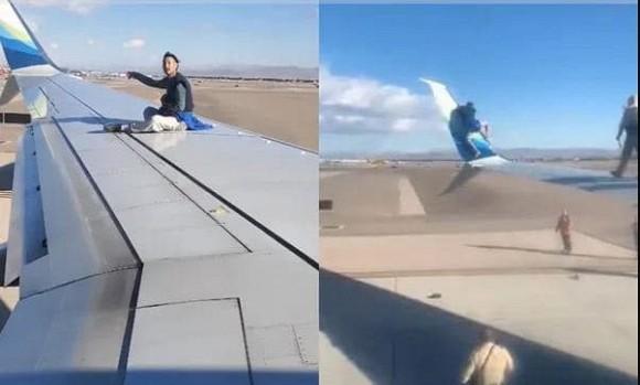 Khoảnh khắc người đàn ông trèo lên cánh máy bay khi chuẩn bị lăn bánh khiến người xem đứng hình-3