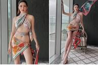 Hoa hậu Lương Thùy Linh lấy khăn lụa quấn làm váy táo bạo khoe body 'cực phẩm'