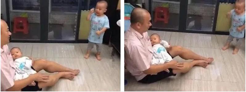 Ông bố âu yếm ru con gái ngủ nhưng ai cũng phì cười vì thái độ của con trai lớn-2