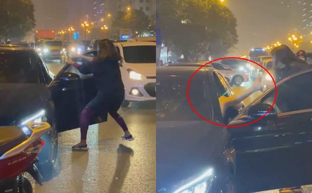 Vụ người phụ nữ chặn đầu xe Mercedes đánh ghen trên phố Hà Nội: Khi cảnh sát đến đã giải tán-1