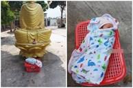 Bé trai 5 ngày tuổi quấn kín khăn, bị bỏ rơi trong chiếc giỏ bên cạnh tượng Phật ngày cận Tết