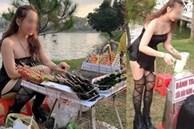 Cô gái gây khó hiểu khi diện đầm không dây, kèm tất lưới hở đùi táo bạo để... đứng bán đồ ăn vặt ở hồ Than Thở, Đà Lạt