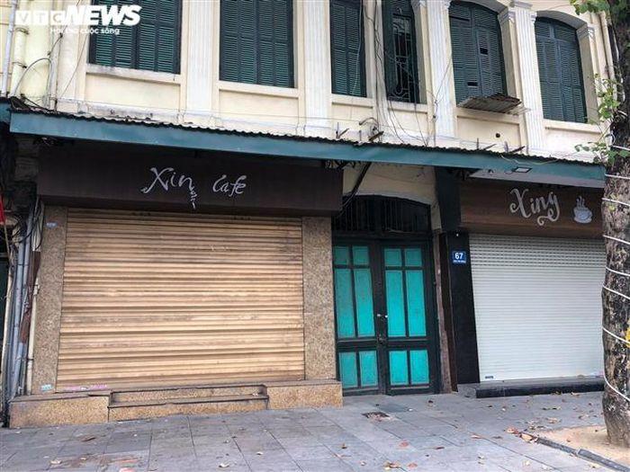 Hàng quán phố cổ Hà Nội nghỉ Tết kéo dài, khách sạn rao bán la liệt bằng tờ rơi-10