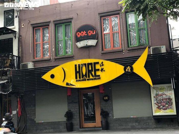 Hàng quán phố cổ Hà Nội nghỉ Tết kéo dài, khách sạn rao bán la liệt bằng tờ rơi-16