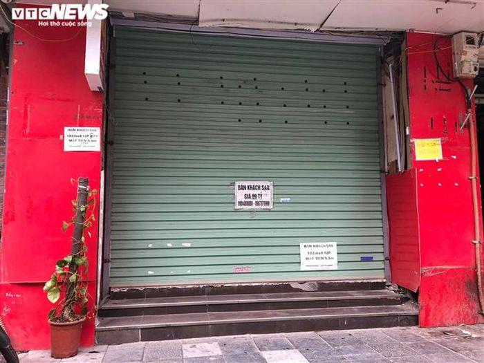 Hàng quán phố cổ Hà Nội nghỉ Tết kéo dài, khách sạn rao bán la liệt bằng tờ rơi-5