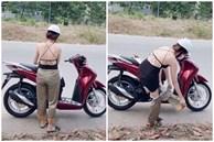 Đang đi trên đường, cô gái dừng xe lột đồ khiến ai cũng choáng váng