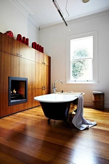 Ý tưởng thiết kế phòng tắm thân thiện với môi trường:Thảm lót chân bằng đá haygiá đỡ khăn bằng dây cũng không độc đáo bằng việc lắp thêm lò sưởi-2