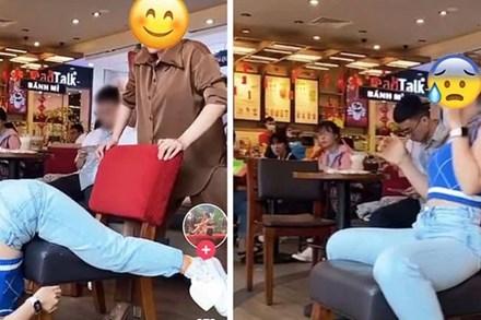 Hai cô gái bị chê kém duyên vì nằm dài giữa quán cà phê Highlands, kéo ghế đu trend khoe body giống Ngọc Trinh