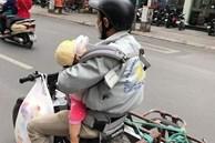 Tranh cãi hình ảnh ông bố chở đồ cồng kềnh vẫn địu con gái trước ngực tham gia giao thông