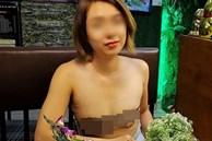 Người phụ nữ ở Sài Gòn từng gây bão vì để ngực 'trần' đưa gia đình đi khắp nơi tiếp tục bị chỉ trích vì mặc áo màu da lộ rõ vòng 1 đi ăn hàng