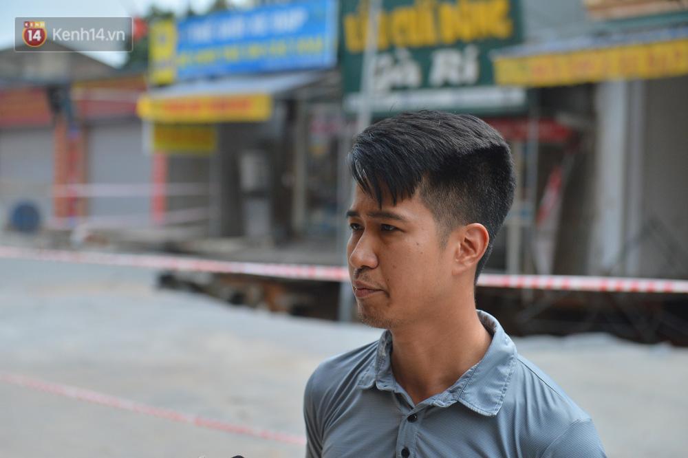 Cuộc sống đảo lộn sau 1 tuần xuất hiện hố tử thần ở Hà Nội: Công việc làm ăn bị đình trệ, con cháu phải mang đi gửi-3