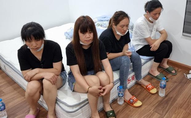 Hà Nội: Cảnh sát phá cửa nhà phát hiện 12 người Trung Quốc nhập cảnh chui cố thủ bên trong-1