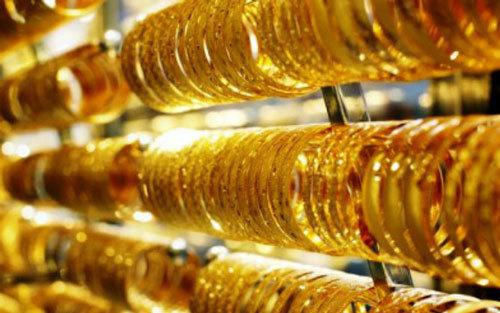 Giá vàng hôm nay 14/5: Áp lực đè nặng, vàng tụt giảm-1