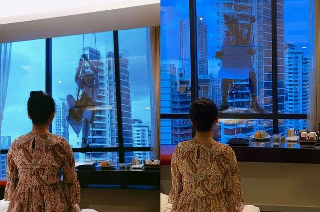 Nhìn ra cửa kính tòa nhà từ tầng 17, cô gái ngạc nhiên khi thấy bạn trai treo lơ lửng, nội dung trên tờ giấycầm mới bất ngờ!-2