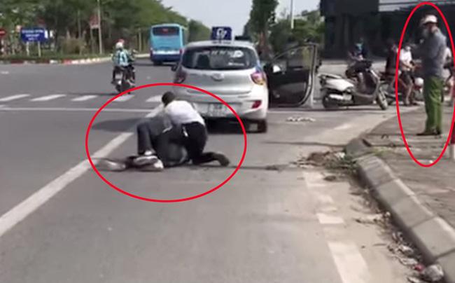 Đại úy công an giải trình thế nào về việc đứng bấm điện thoại, để tài xế taxi một mình vật lộn với tên cướp trốn truy nã?-2