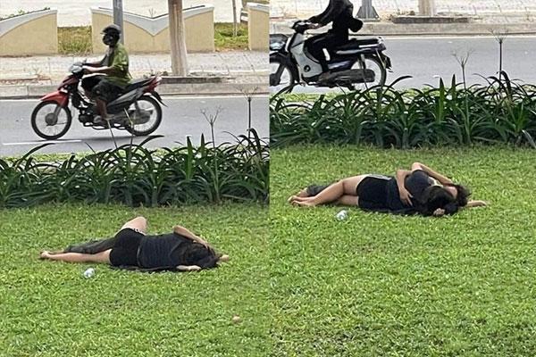 Cặp đôi nằm ôm hôn nhau thắm thiết trên bãi cỏ, mặc kệ xe cộ qua lại xung quanh-1