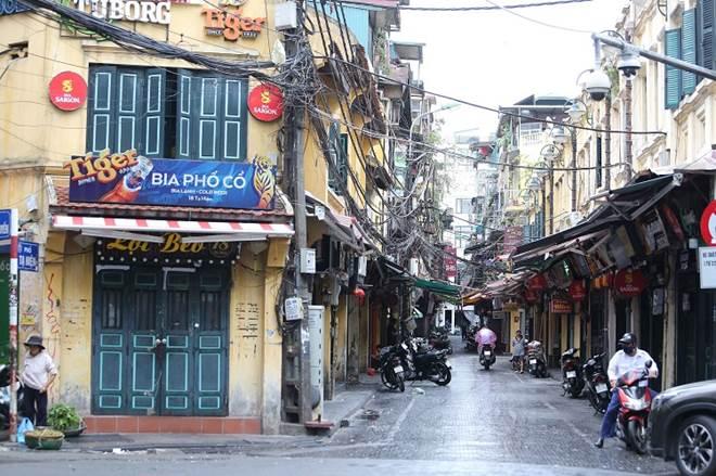"""Loạt phố ẩm thực xuyên đêm"""" ở Hà Nội lao đao vì dịch, tiểu thương bỏ quán về quê-1"""