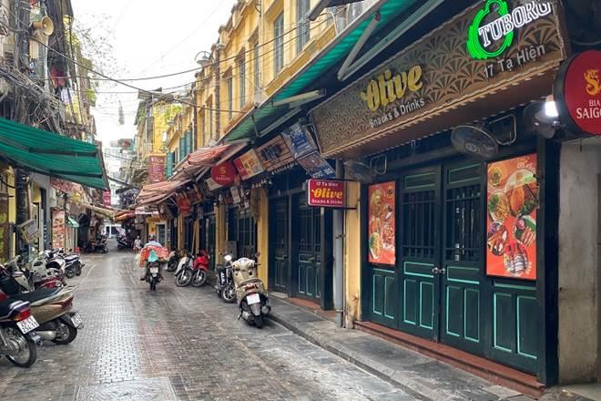 """Loạt phố ẩm thực xuyên đêm"""" ở Hà Nội lao đao vì dịch, tiểu thương bỏ quán về quê-5"""