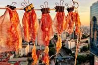 Cô gái ở Hà Nội mang mực ống, thịt ba chỉ lên tận văn phòng để phơi, tận dụng nhân lúc thời tiết đang nóng cao độ và kết quả thật bất ngờ