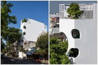 Ngôi nhà cắt khoét siêu 'art' chiếm spotlight cả khu phố: Design bên trong xịn không kém, sân thượng chill như quán cafe