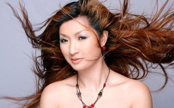 Nhan sắc thời trẻ của Nguyễn Hồng Nhung - nữ ca sĩ khổ sở vì scandal lộ clip nóng-3
