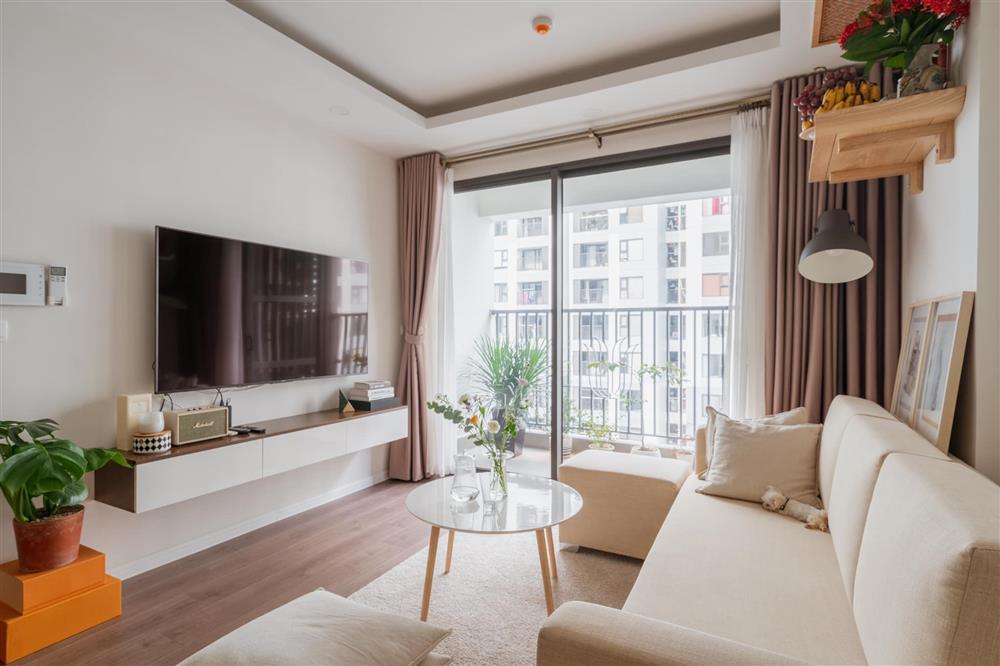 Căn hộ chung cư phong cách tối giản với tone màu trắng kem đầy ấn tượng, sạch sẽ tươm tất mà không kém phần sang chảnh-1