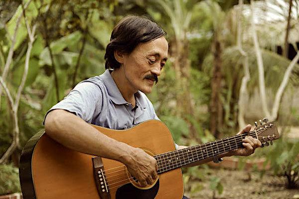 Con trai nghệ sĩ Giang còi: Ba tôi muốn được chôn cùng cây đàn guitar-1