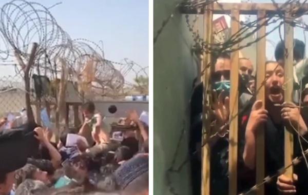 Những bà mẹ Afghanistan tuyệt vọng ném con qua rào chắn, xin người ta đưa chúng đi thật xa: Quặn lòng ánh mắt những đứa trẻ tìm mẹ-2