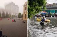 Ảnh, clip: TP Hải Phòng chìm trong biển nước sau cơn mưa lớn, người dân bì bõm dắt xe máy trên đường