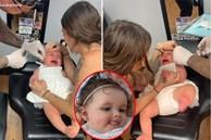 """Bé gái 6 tháng tuổi vùng vẫy khóc lóc khi đượcđưa đi bấm lỗ tai và lý lẽ gây tranh cãi của người mẹ: """"Tôi có quyền"""""""