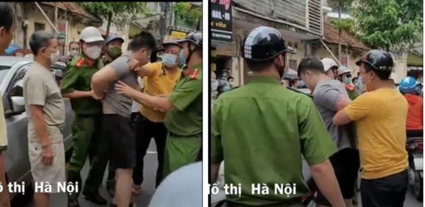 Tài xế lái ô tô gây náo loạn phố Hà Nội, công an cầm gạch ném cửa xe để khống chế đối tượng-3